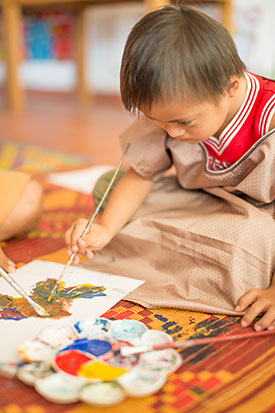 [Photo: A Child Painting]